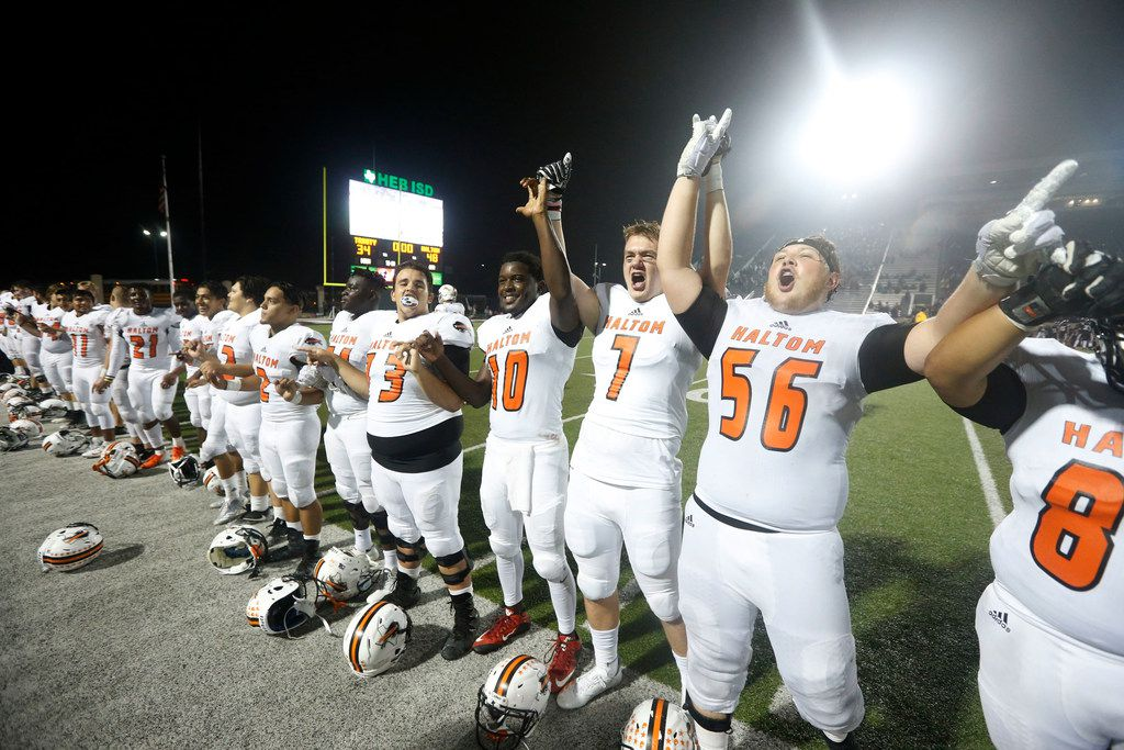 Haltom players celebrate their 48-34 win over Euless Trinity last season. (Michael Ainsworth/Special Contributor)