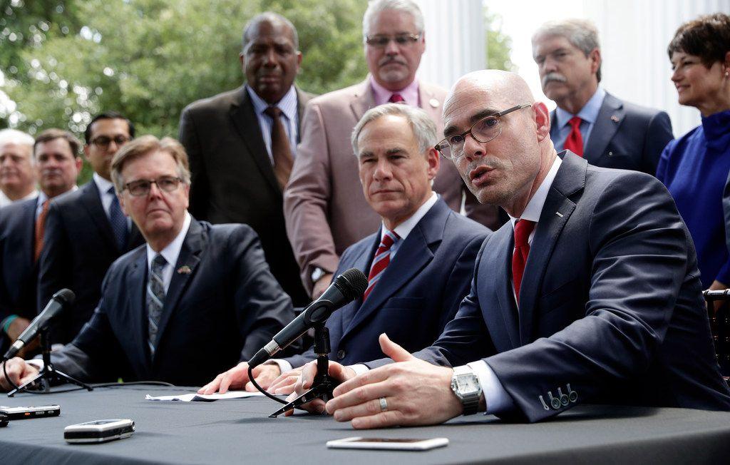 Lt. Gov. Dan Patrick, seated left, Gov. Greg Abbott, seated center, and Speaker of the House Dennis Bonnen, seated right, in Austin on Thursday, May 23, 2019.