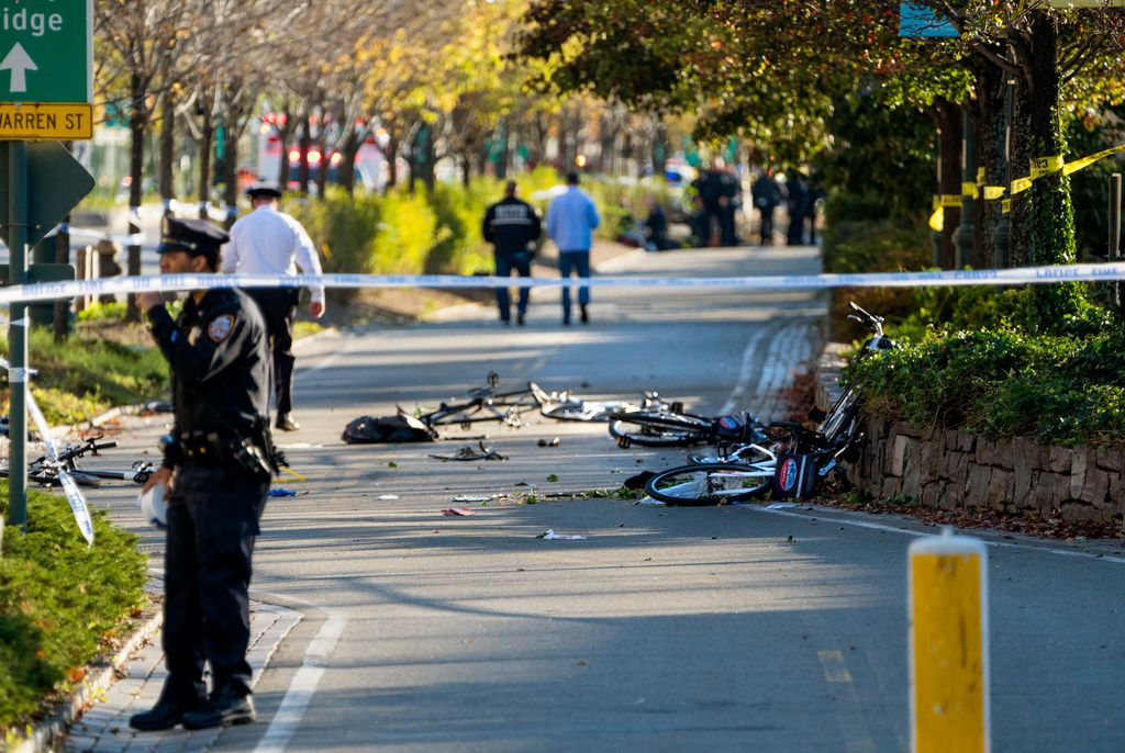 Bicycles and debris lay on a bike path after a motorist drove onto the path near the World Trade Center memorial, striking and killing several people Tuesday, Oct. 31, 2017, in New York.