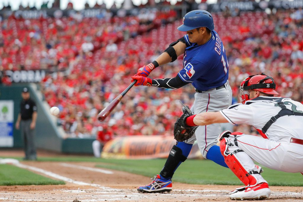 Texas Rangers' Shin-Soo Choo grounds into a fielder's choice before reaching first base safely in the second inning of a baseball game against the Cincinnati Reds, Friday, June 14, 2019, in Cincinnati. (AP Photo/John Minchillo)