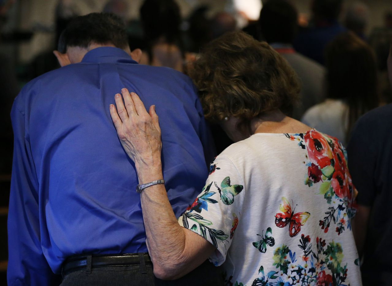 Worshippers embrace during worship service at Arcadia First Baptist Church in Santa Fe, Texas, Sunday, May 20, 2018. On Friday morning May 18, 10 people were killed and 13 were injured after a shooting at Santa Fe High School. (Andy Jacobsohn/The Dallas Morning News)