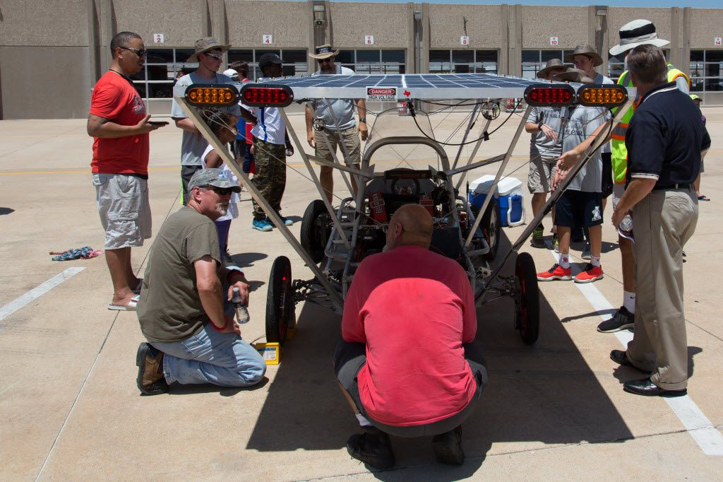 Visitors look at the Liberty Christian solar-powered car during the Solar Car Challenge event at the Texas Motor Speedway.  This is Liberty Christian's 10th time entering the competition.  The Solar Car Challenge will depart Sunday from the Northwest ISD Administration building, just west of Texas Motor Speedway, and the trip concludes July 23 in Mendota Heights, Minn., outside Minneapolis., Wednesday, July 13, 2016, in Fort Worth, Texas. Jeff Woo/DRC