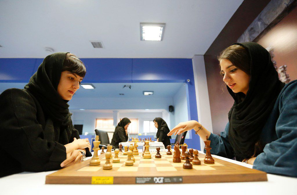 Iranian chess players Mitra Hejazipour (L) and Sara Khademalsharieh play at the Chess Federation in the capital Tehran on October 10, 2016. For the Iranian players the veil is not a sign of oppression, they oppose a campaign launched in the United States against the holding of the Women's World Championship in February in Tehran.
