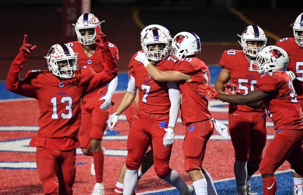 Parish Episcopal senior wide receiver Tyler Hamilton (7) is congratulated by teammates after his touchdown reception against Bishop Lynch during the second half of a high school football game on Friday, October 19, 2018 at Gloria H. Snyder in Dallas.  Parish won 27-20. (Jeffrey McWhorter/Special Contributor)