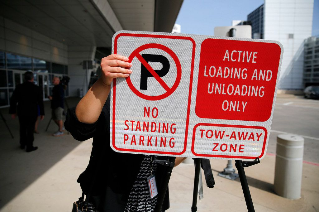 Pick-up and drop-off at DFW Airport terminals is about to change.  Starting in September, after the proper signage (like this one) is in place, officials are not going to allow people to wait in their vehicles at the curb. (Tom Fox/The Dallas Morning News)