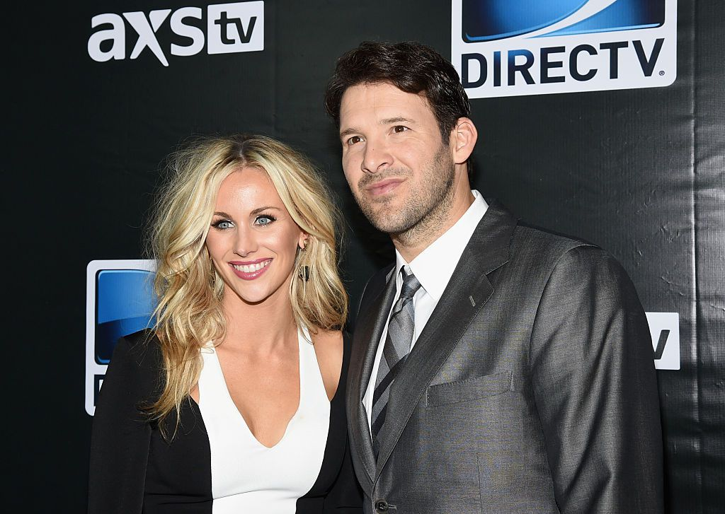 GLENDALE, AZ - JANUARY 31:  Candice Crawford (L) and Dallas Cowboys quarterback Tony Romo attend DirecTV Super Saturday Night hosted by Mark Cuban's AXS TV and Pro Football Hall of Famer Michael Strahan at Pendergast Family Farm on January 31, 2015 in Glendale, Arizona.  (Photo by Ethan Miller/Getty Images for DirecTV)