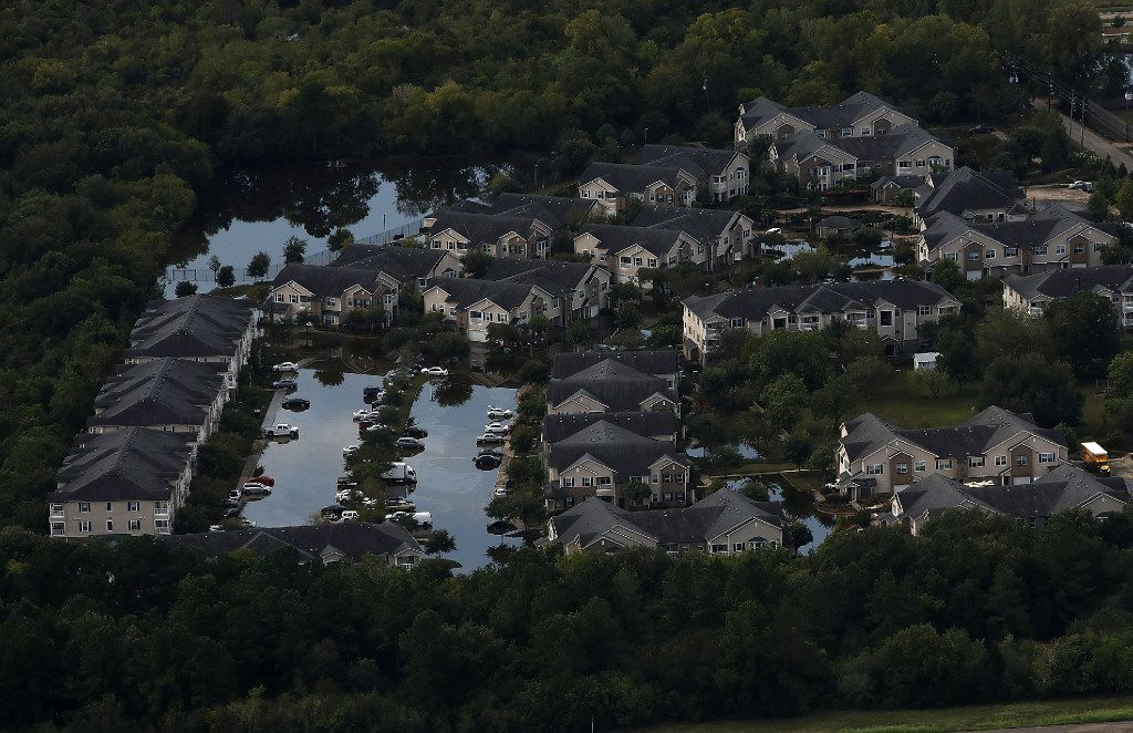 A Houston housing development sits in floodwaters over a week after  Hurricane Harvey hit Southern Texas.