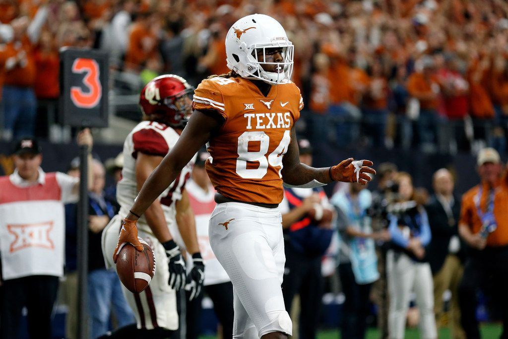 Texas Longhorns wide receiver Lil'Jordan Humphrey walks off the field after scoring a touchdown against the Oklahoma Sooners during the second half of the NCAA Big 12 Conference football championship, Saturday, Dec. 1, 2018, in Arlington, Texas. Oklahoma defeated Texas 39-27. (AP Photo/Roger Steinman)