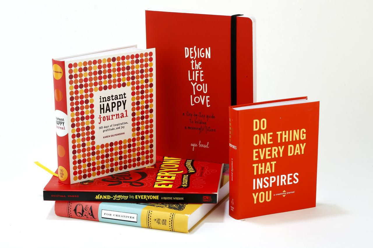 """Instant Happy Journal,"" ""Design the Life You Love,"" ""Do One Thing Every Day That Inspires You,"" ""Q & A a Day for Creatives,"" and ""Hand Lettering for Everyone,"" clockwise from left. (Michael Tercha/Chicago Tribune/TNS)"
