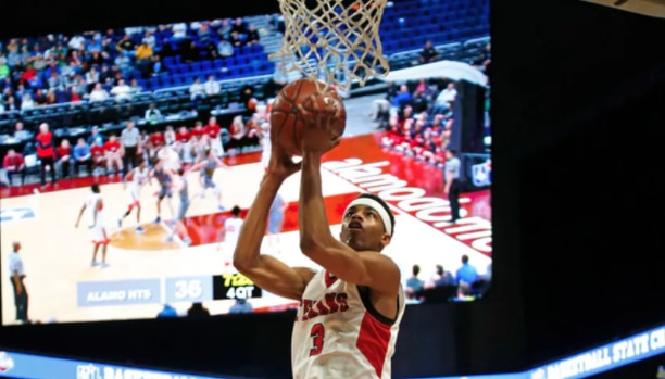 Justin Northwest's Avery Anderson scores a basket during a Class 5A state semifinal against San Antonio Alamo Heights on Thursday, March 8, 2018 at the Alamodome. (Ronald Cortes/Special Contributor)