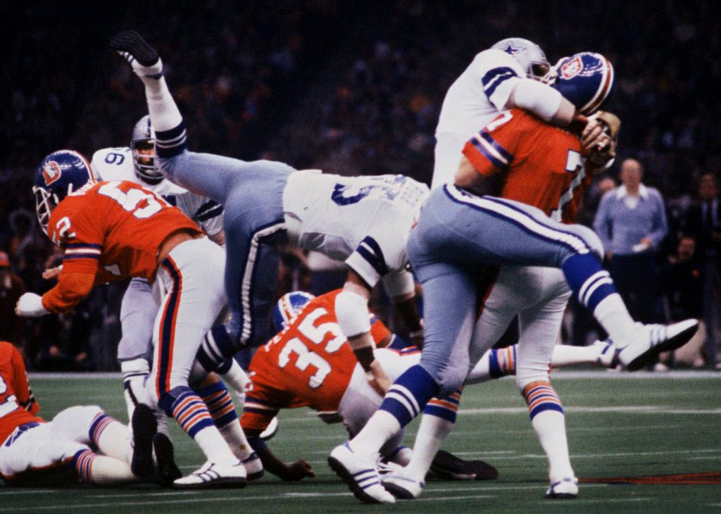 The Dallas Cowboys 'DoomsDay' defense, including Harvey Martin (79 - atop the Denver QB) and Jethro Pugh (75) smother the Denver Broncos QB Craig Morton (7) in the first quarter of Super Bowl XII in New Orleans. (1-15-78). JOHN RHODES/DALLAS MORNING NEWS