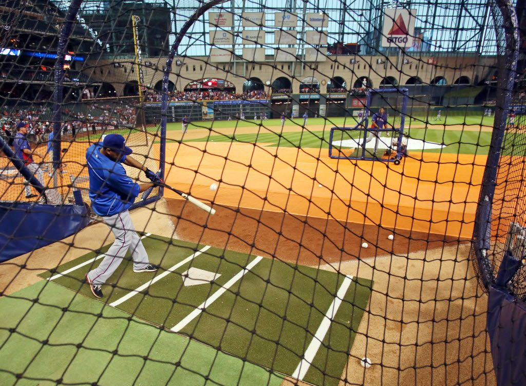 Texas outfielder Nelson Cruz hits during batting practice before the Texas Rangers vs. Houston Astros season opener at Minute Maid Park in Houston on Sunday, March 31, 2013. (Louis DeLuca/The Dallas Morning News)