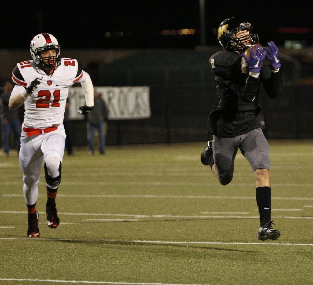 Mansfield's Jackson Gleeson (8) makes a reception for a touchdown in front of Flower Mound Marcus's Eli Mckay (21) in the first half at Birdville Fine Arts Stadium in North Richland Hills, Texas November 20, 2015.   (Nathan Hunsinger The Dallas Morning News)