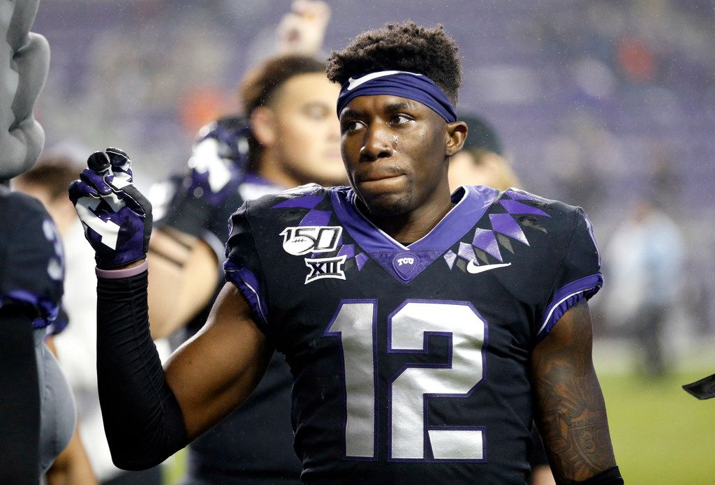 TCU Horned Frogs senior cornerback Jeff Gladney (12) joins his teammates in the school song following their loss to West Virginia Mountaineers at Amon G. Carter Stadium in Fort Worth, Friday, November 29, 2019. (Tom Fox/The Dallas Morning News)