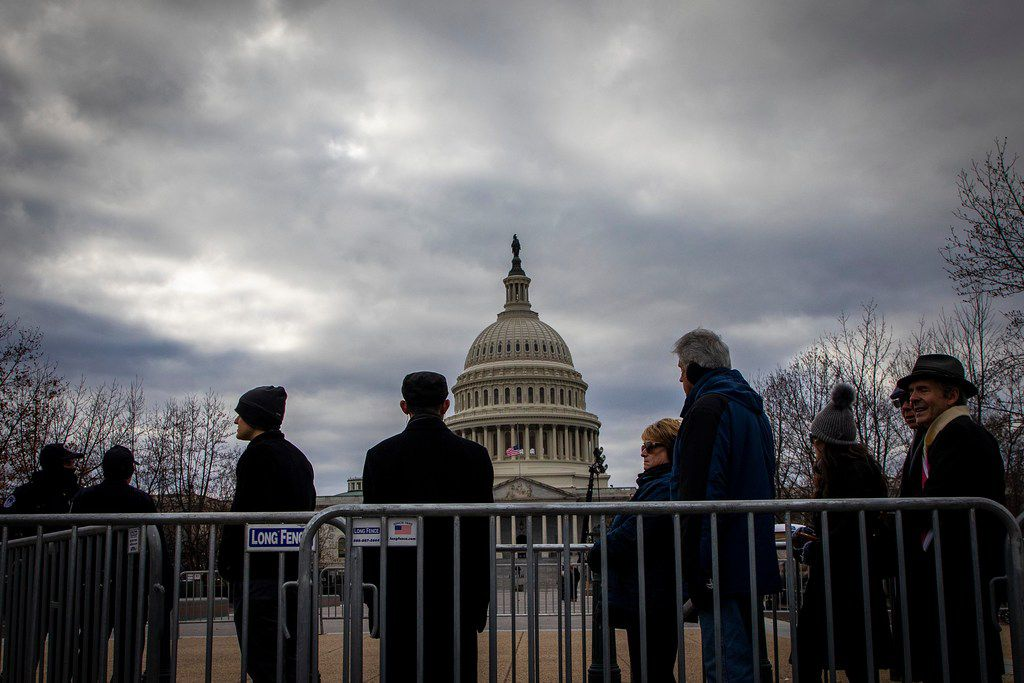 People wait in line to enter the U. S. Capitol to pay their respects to President George H.W. Bush as he lies in the Rotunda of the U.S. Capitol on Tuesday, Dec. 4, 2018, in Washington.