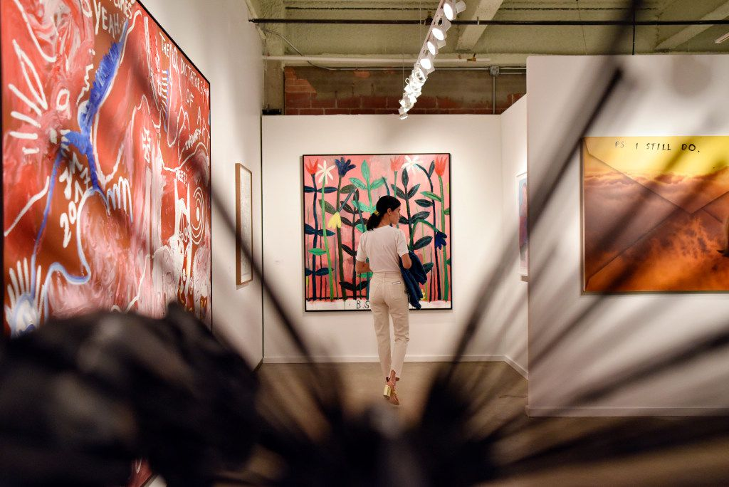 Mexico City artist Pia Camil browses a gallery during the Preview Gala of Dallas Art Fair. (Ben Torres/Special Contributor)
