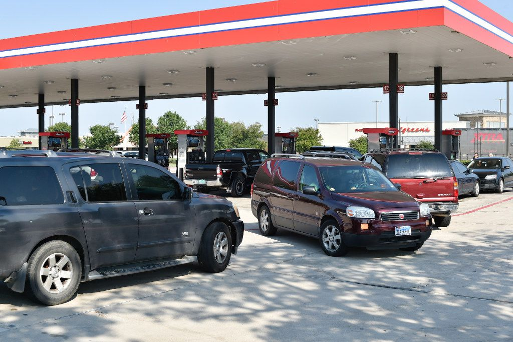 Customers waited in line just before Labor Day weekend to fill up their vehicles at a RaceTrac near South Loop 288 and Brinker Road in Denton.  (Jeff Woo/Denton Record-Chronicle)