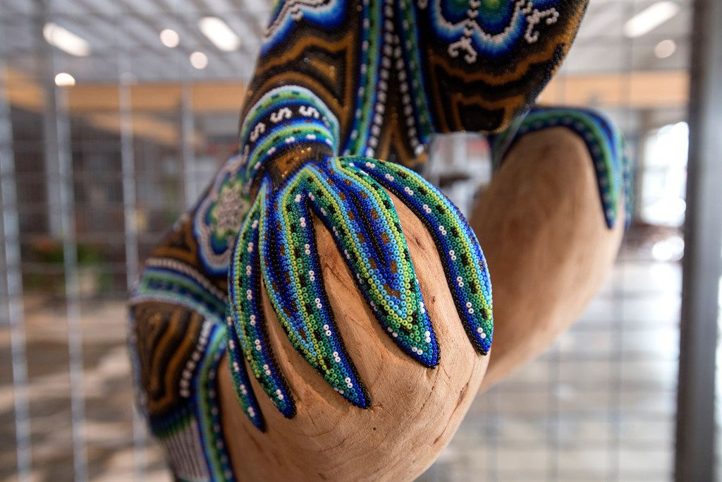 Detail of a hand-crafted, beaded iguana sculpture by Mexican artist Santos Bautista.