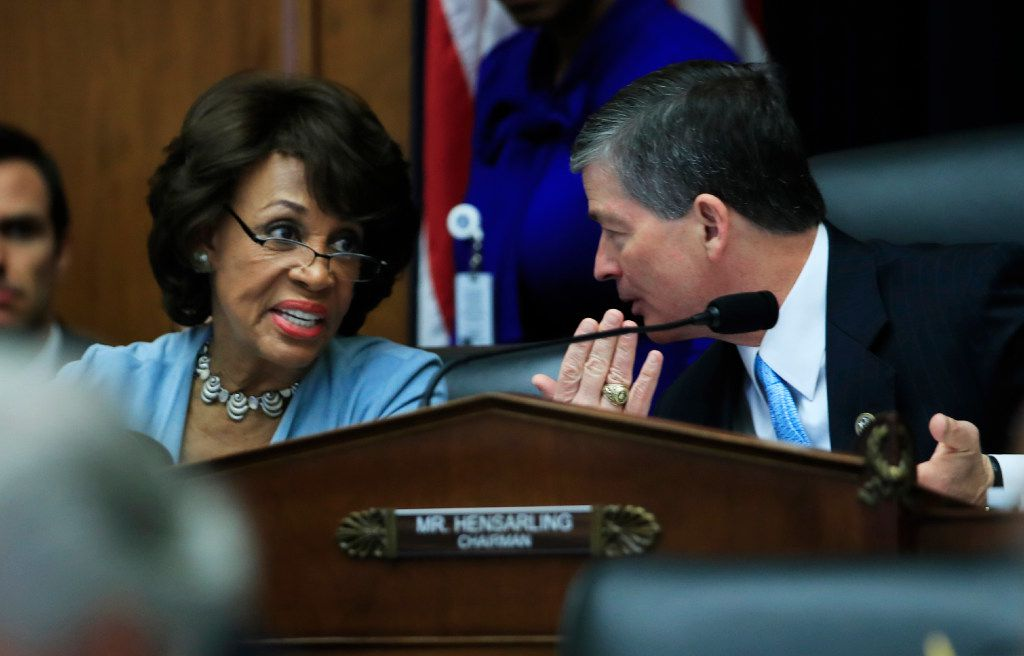 House Financial Services Committee Chairman Rep. Jeb Hensarling, R-Texas, talks with the committee's ranking member Rep. Maxine Waters, D-Calif. on Hill in Washington, Tuesday, May 2, 2017, during the committee's hearing on overhauling the nation's financial rules.