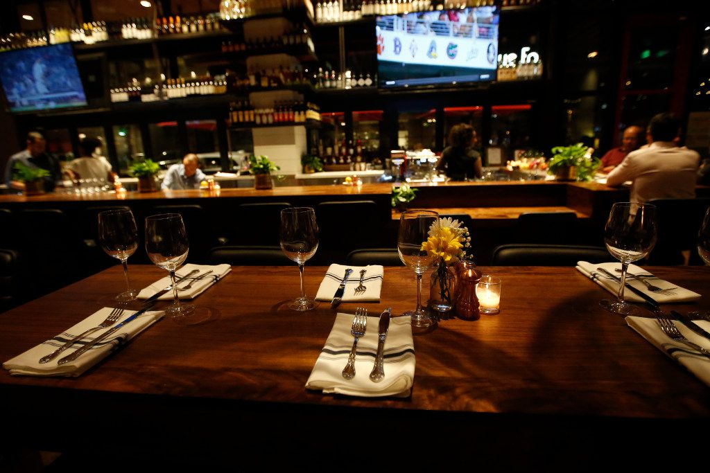A table is set in front of the bar area at North Italia, at Legacy West, in Plano, Texas, Friday, June 23, 2017.