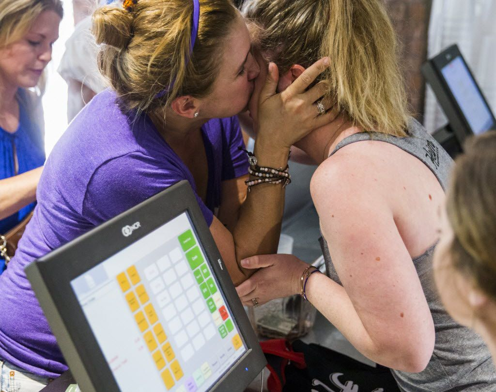 Emily McLaughlin (left) kisses Emma Heim, owner of Heim Barbecue, on the cheek as she orders as the first customer at Heim Barbecue's new location on Saturday, August 6, 2016 on W. Magnolia Ave. in Fort Worth. McLaughlin, Cindy Podner (center) and Jeff Knipper (right) waited in line over night.