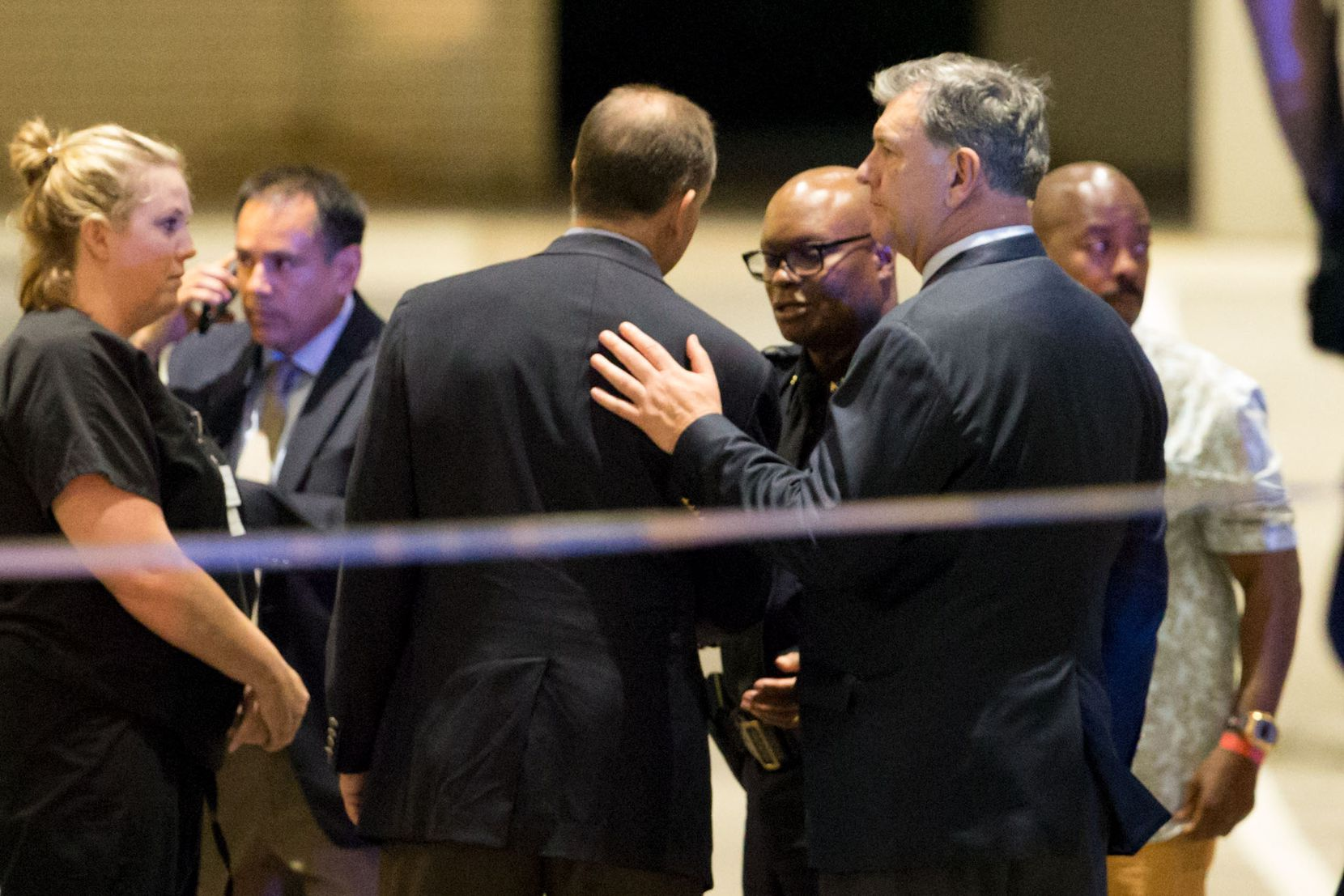 Mayor Mike Rawlings (right) and Police Chief David Brown joined others gathered outside the emergency room at Baylor University Medical Center in the early hours of July 8.