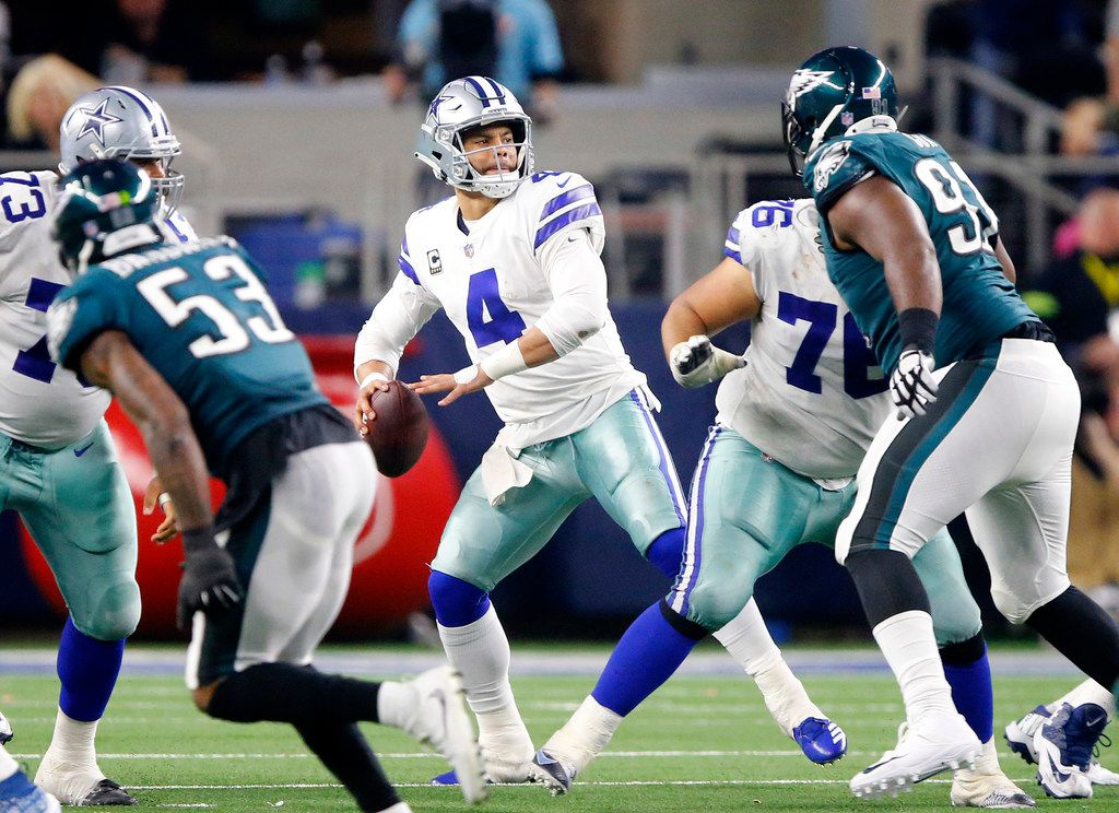 Dallas Cowboys quarterback Dak Prescott (4) looks to pass downfield against the Philadelphia Eagles defense in the fourth quarter at AT&T Stadium in Arlington, Texas, Sunday, December 9, 2018. The Cowboys won in overtime, 29-23. (Tom Fox/The Dallas Morning News)