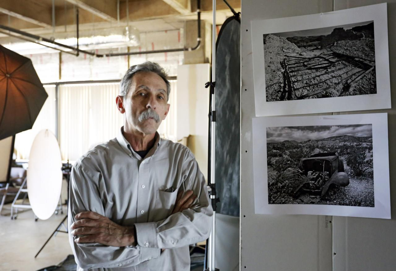 Photographer Terry Cockerham is shown in his studio. Cockerham travels to Big Bend every year for days at a time to take photographs. Some of his best are on display at the Irving Arts Center through June 28.