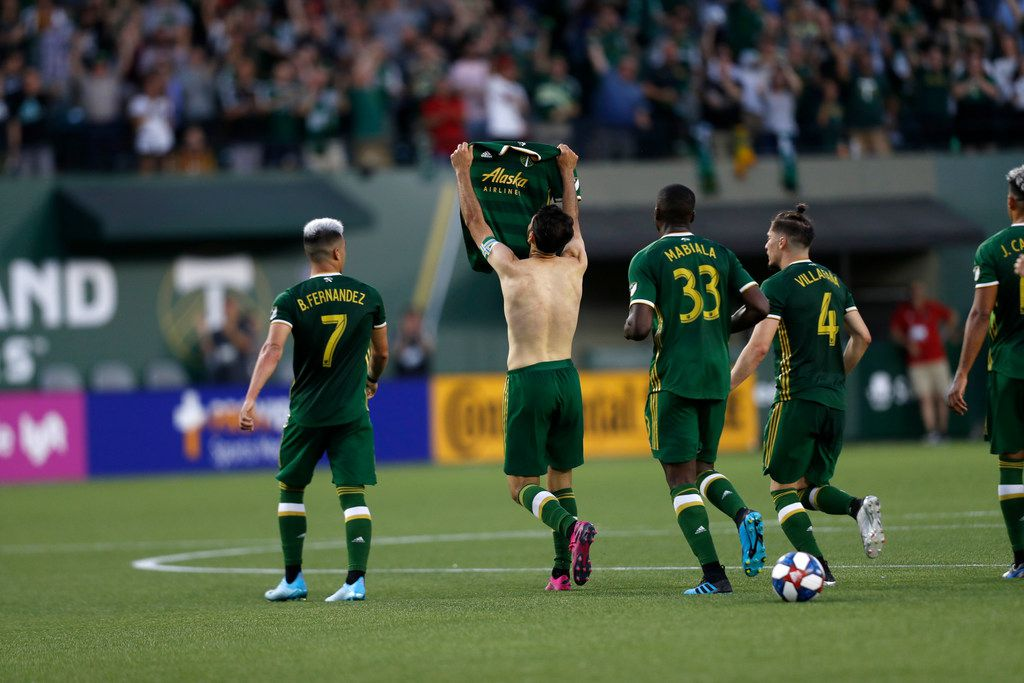 Portland Timbers' Diego Valeri (8) removes his shirt during the first half of an MLS soccer match against the LA Galaxy on Saturday, July 27, 2019, in Portland, Ore. (Noble Guyon/The Oregonian via AP)