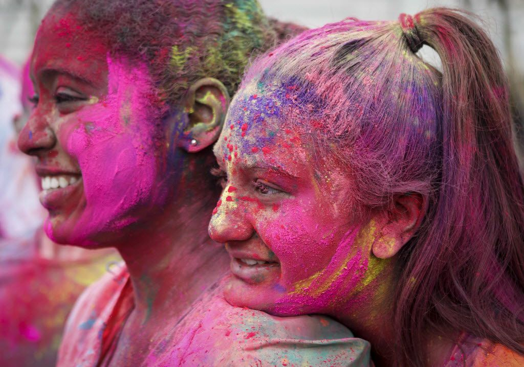 Shivanee Patel (right) rests her head on Brittany Boxill's shoulder during a Holi celebration at the DFW Hindu Temple in Irving.