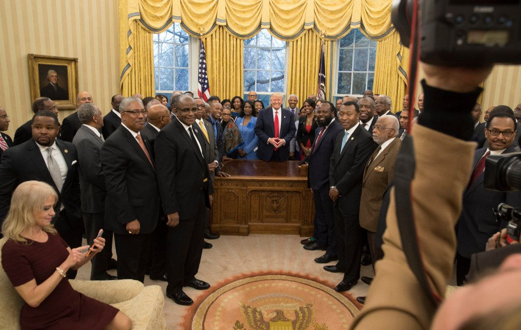 Kellyanne Conway, counselor to the president, checks her phone as President Donald Trump meets with a group of leaders from historically black colleges and universities in the Oval Office of the White House in Washington, Feb. 27, 2017. Photos of the Conway sitting casually on a couch in the Oval Office have ignited a battle over decorum. (Stephen Crowley/The New York Times)