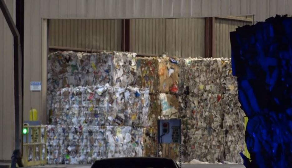 Bales of recycled material sit at a warehouse in East Fort Worth where a woman was killed Thursday morning.