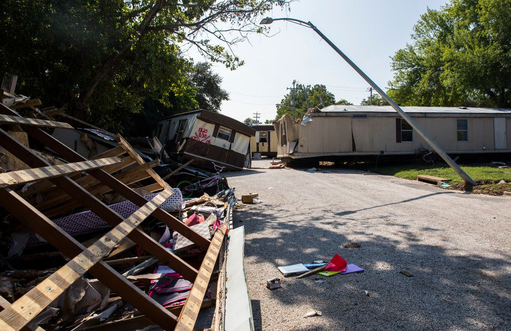 Homes and debris are left in the Country Way Village Mobile Home Park on Wednesday, October 11, 2017 in La Grange, Texas. Major flooding damaged hundreds of homes in the city due to flooding from Hurricane Harvey in late August. Record amounts of rain caused the Colorado River, which borders La Grange, to raise up about 54 feet. (Ashley Landis/The Dallas Morning News)