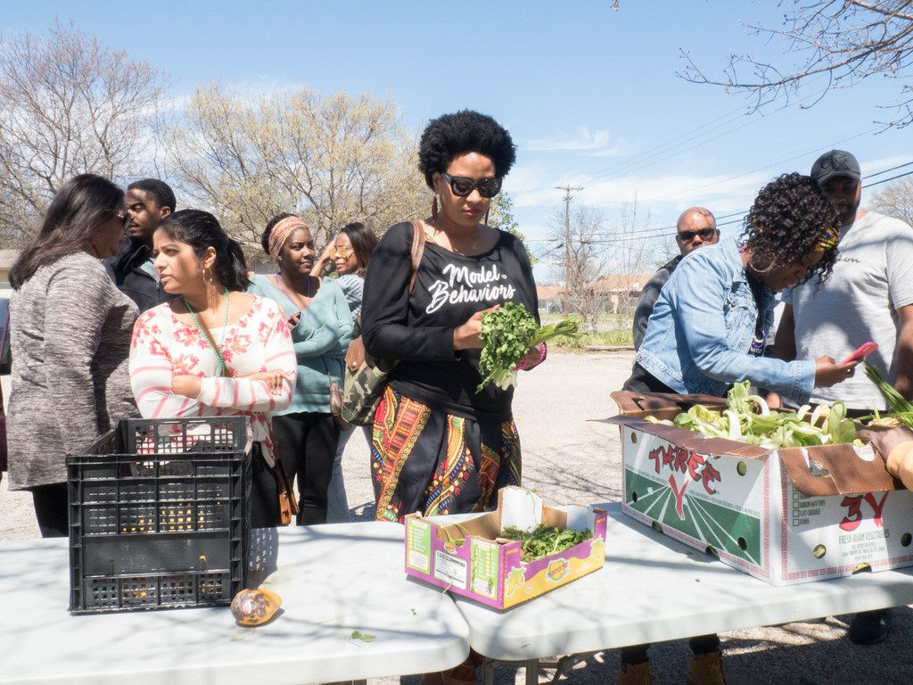 Attendees of the Soul of Dallas Bus tour visit the Oak Cliff Veggie Project in Dallas, Saturday, March 16 2019. Each third Saturday of the month This initiative provides fresh vegetables to the community free of charge.