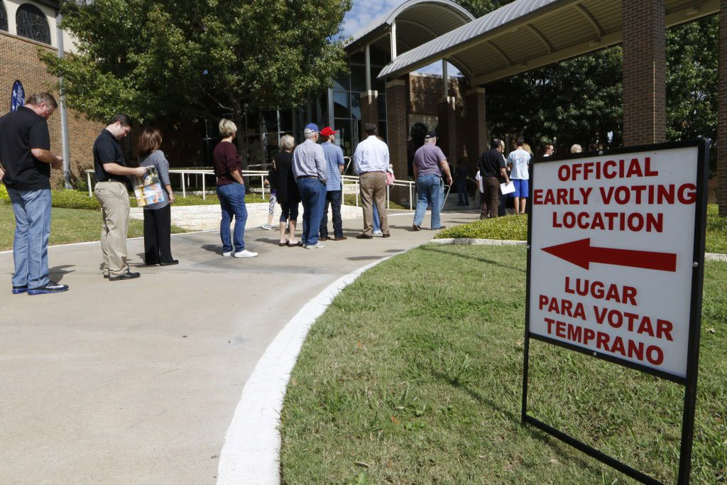 Voters wait to cast ballots early at Our Redeemer Lutheran Church in Dallas on Monday. Today is the start of early voting.