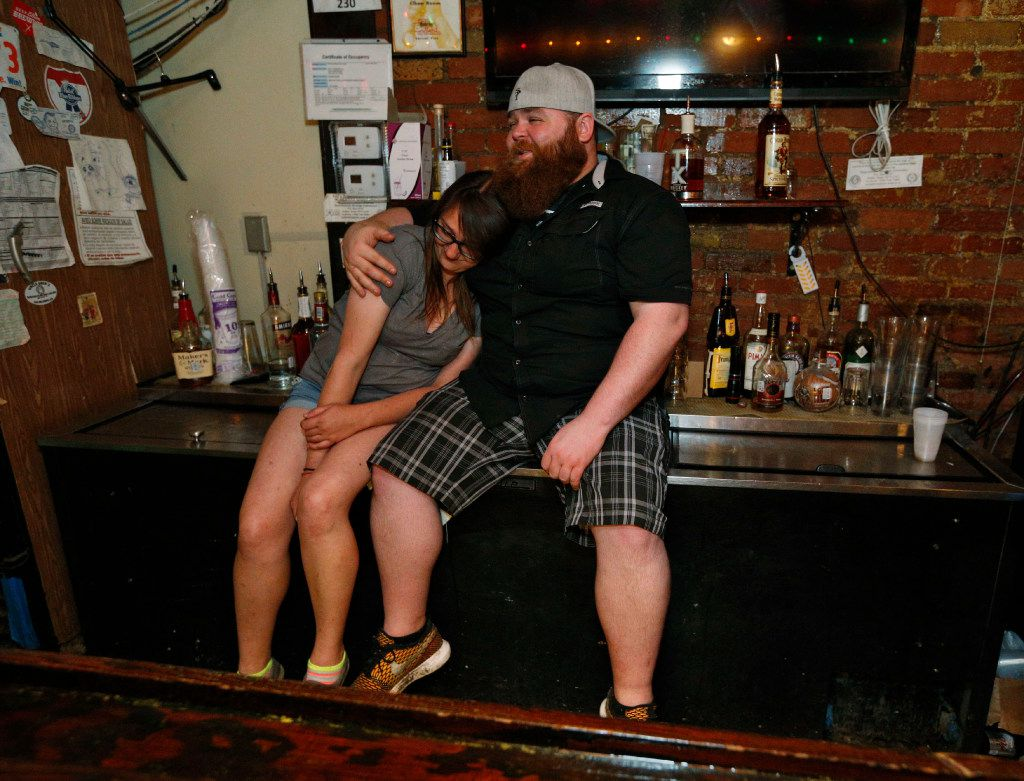 Holly Terry and Tommy Morton comfort one another after closing of Elbow Room in Dallas on April 16, 2017. (Nathan Hunsinger/The Dallas Morning News)