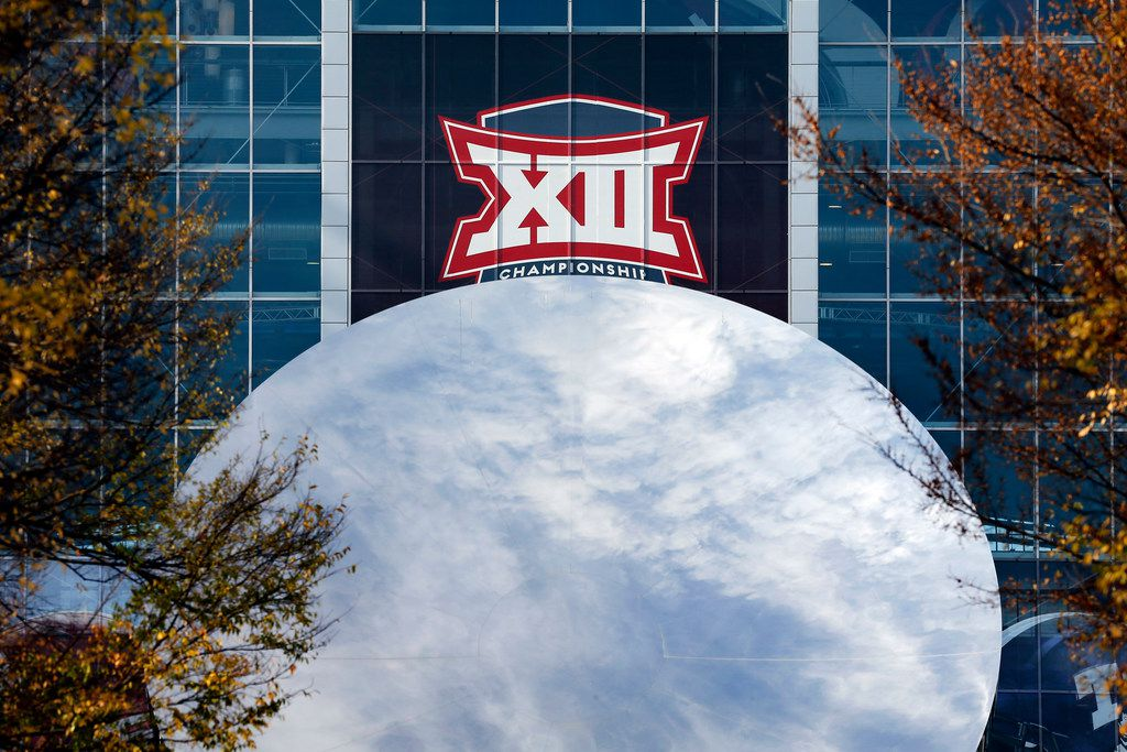 The Big XII Championship logo appears over the Sky Mirror sculpture outside AT&T Stadium before the Oklahoma Sooners face the TCU Horned Frogs in Arlington, Texas, Saturday, December 2, 2017. (Tom Fox/The Dallas Morning News)