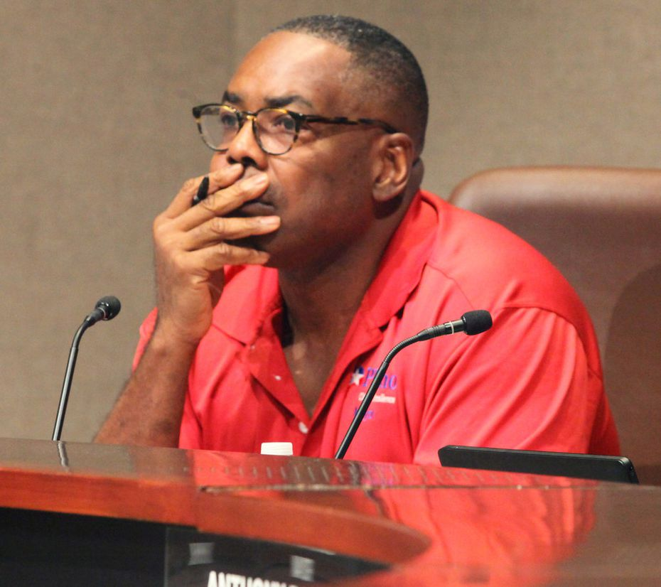 Plano Mayor Harry LaRosiliere listens to The Turning Point executive director speak from the podium during a work session Saturday, Aug. 17, 2019.