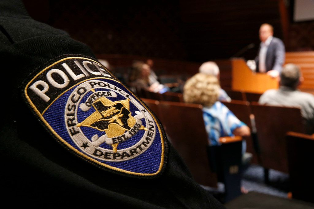 Frisco police chief John Bruce (not seen) listens to Mayor Jeff Cheney talks about safety improvements in the school district in Frisco, Texas on April 13, 2018.