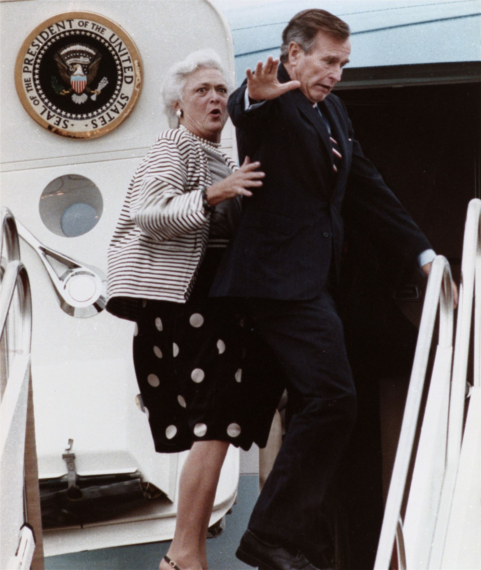 1989: First lady Barbara Bush reacts after President Bush accidentally stepped on her toe while boarding Air Force One at Andrews Air Force Base, Md.