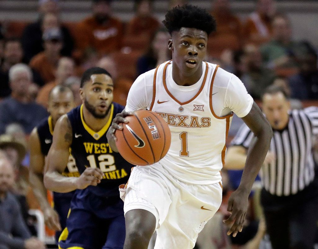 """FILE - In this Jan. 14, 2017, file photo, Texas guard Andrew Jones (1) brings the ball up court during the second half of an NCAA college basketball game against West Virginia in Austin, Texas. The announcement that Jones was diagnosed with leukemia prompted concern and well wishes from across college basketball. He is now starting to offer glimpses of how he's coping with his treatment, and sending """"thank you"""" messages for the emotional and financial support that have poured in to help. (AP Photo/Eric Gay, File)"""
