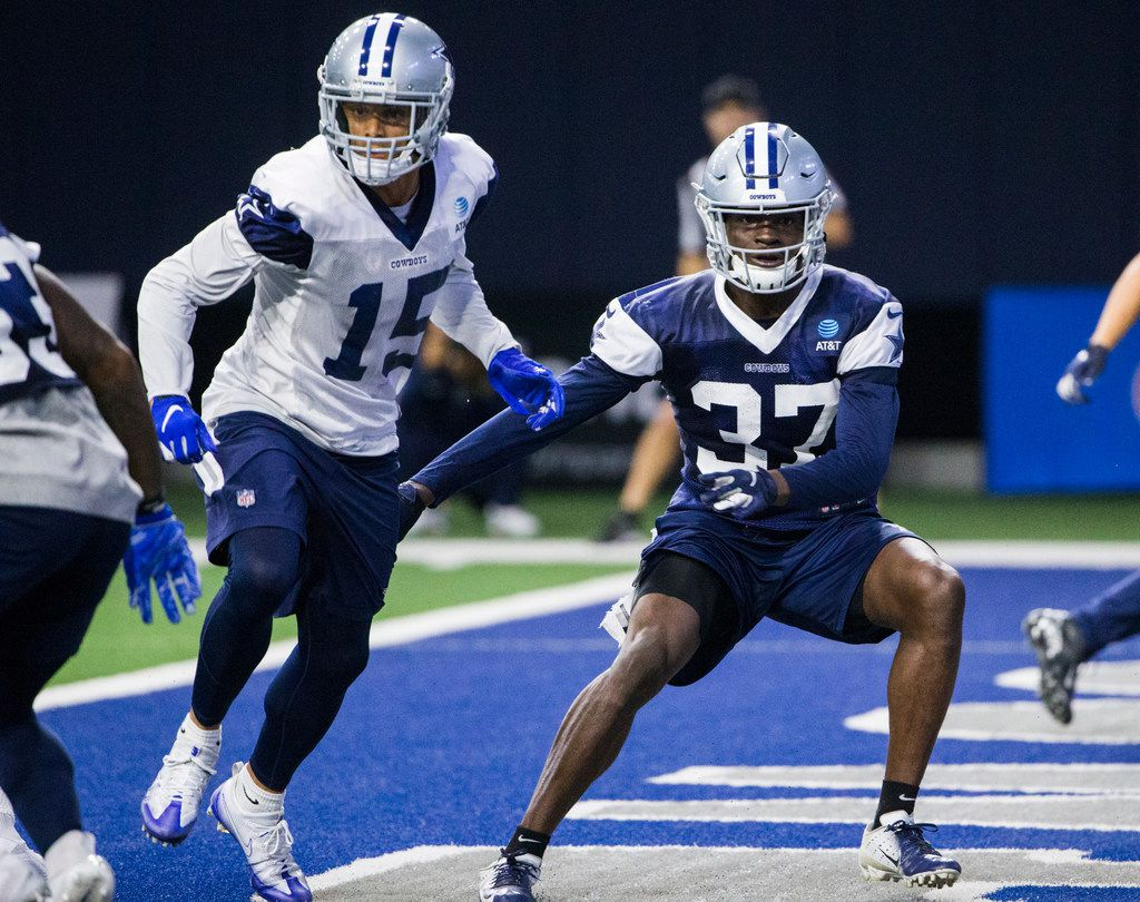 Dallas Cowboys defensive back Donovan Wilson (37) defends against wide receiver Devin Smith (15) during a Dallas Cowboys training camp practice on Thursday, August 22, 2019 at The Star in Frisco. (Ashley Landis/The Dallas Morning News)