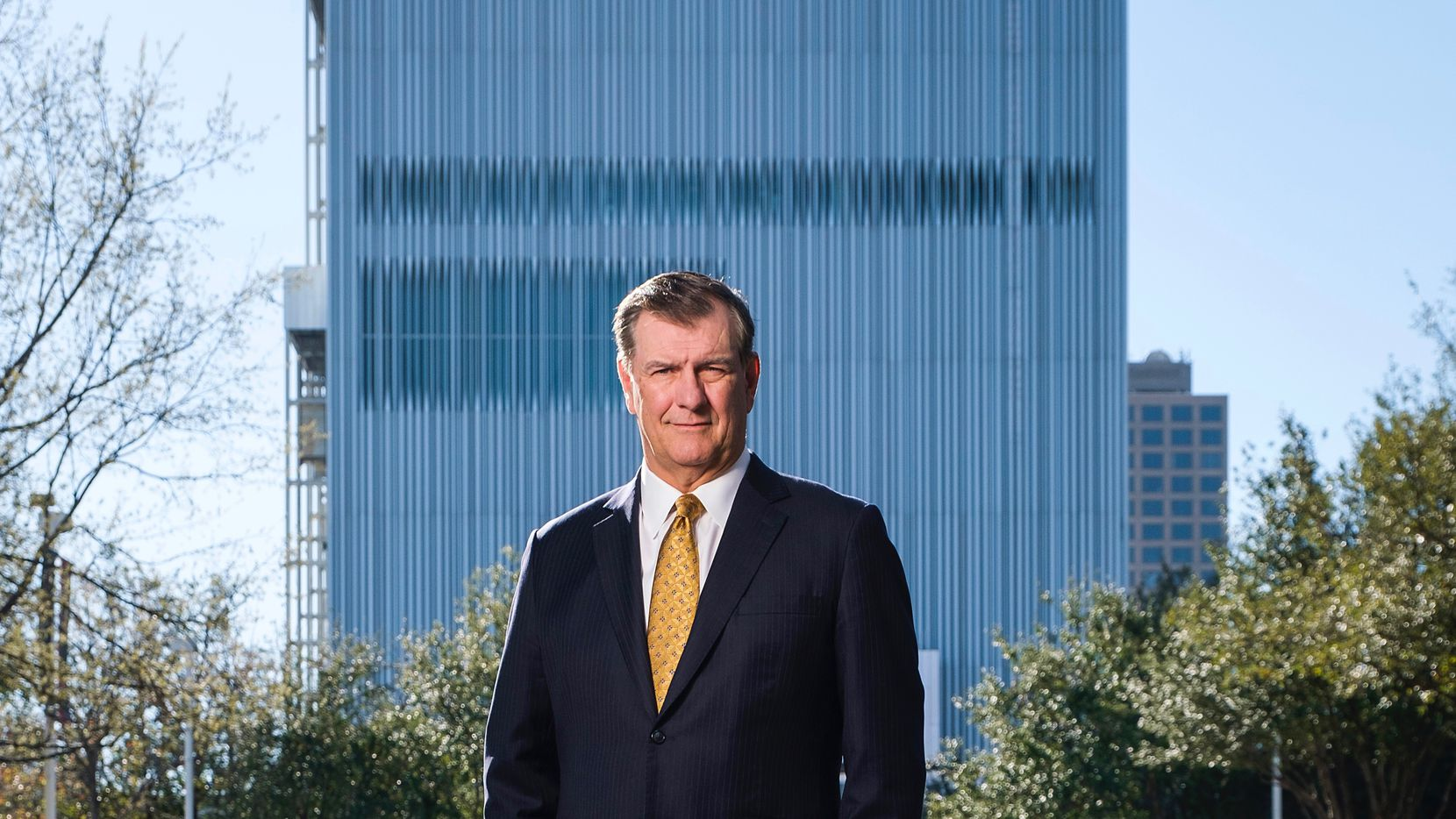 Dallas Mayor Mike Rawlings photographed in the Dallas Arts District with the Wyly Theatre in the background on Thursday, March 21, 2019. (Smiley N. Pool/The Dallas Morning News)