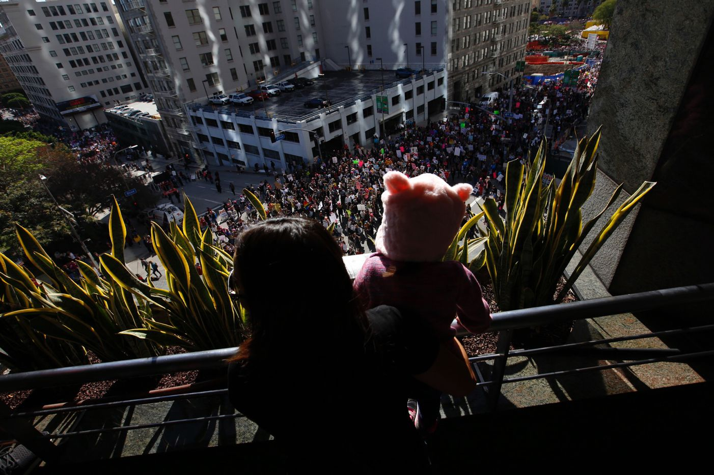 Gina Corpus and her daughter Camila, 2, watch the women's march in Los Angeles on Saturday, Jan. 21, 2017.