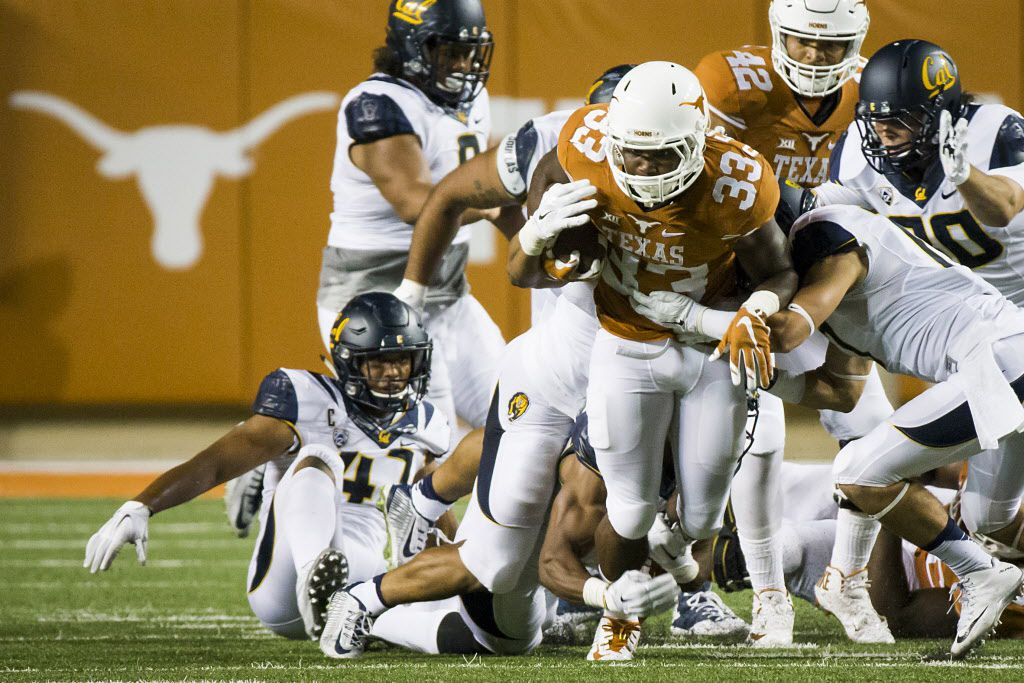 Texas running back D'Onta Foreman (33) is brought down by the California defense during the third quarter of an NCAA football game at Royal Memorial Stadium on Saturday, Sept. 19, 2015, in Austin. (Smiley N. Pool/The Dallas Morning News)