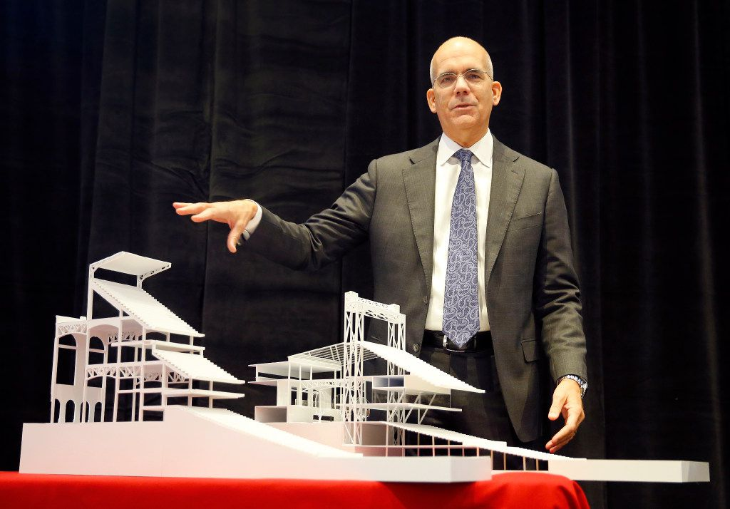 HKS executive vice president, director of sports & entertainment Bryan Trubey points to models of what the new Texas Rangers ballpark seating will look like when designed. The difference between the new (left) and existing (right) seating structure is that the seating configuration gives the fan a more intimate feel to the game by putting them closer to the field. The Texas Rangers baseball organization announced that HKS has been selected to design the new ballpark adjacent to Globe Life Park during a press conference in Arlington, Thursday, January 5, 2017.