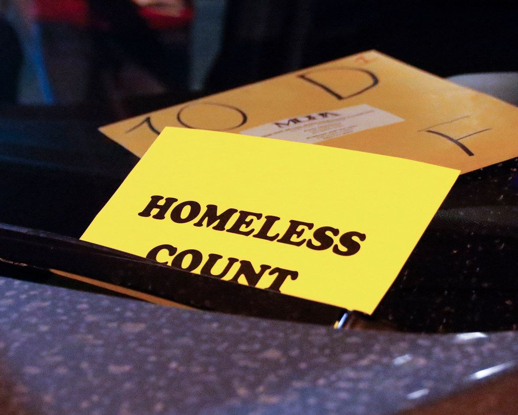 "Dennis Friedel, a volunteer with the Metro Dallas Homeless Alliance, placed a ""homeless count"" card on the dashboard of his truck Jan. 25. Five-person teams conducted the count."