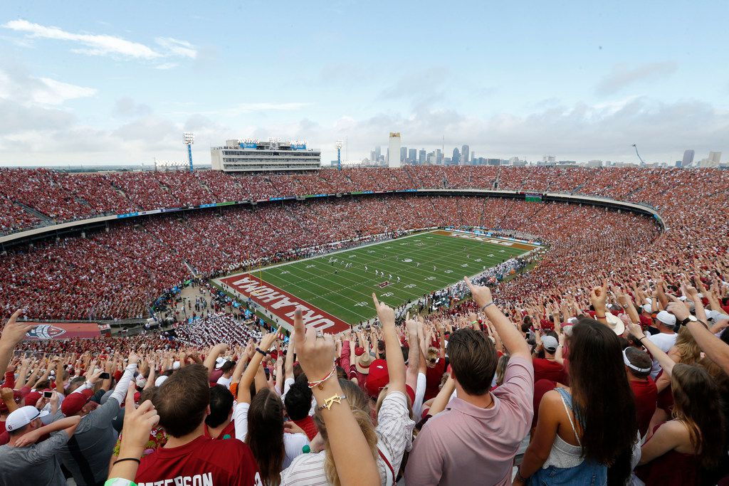 Oklahoma Sooners fans yell as Texas Longhorns kicks the ball off to Oklahoma at the start of a NCAA football game  between Texas Longhorns and the Oklahoma Sooners at the Cotton Bowl in Dallas on Saturday, October 6, 2018. (Vernon Bryant/The Dallas Morning News)