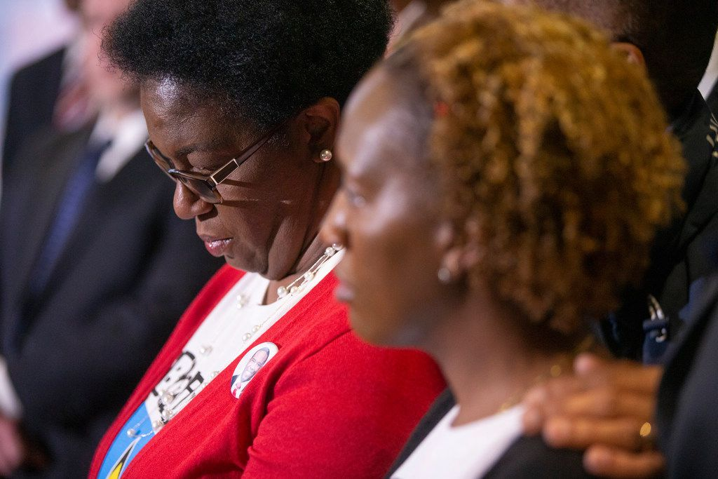 Allison Jean, center, Botham Shem Jean's mother, speaks at a news conference Friday, Nov. 30, 2018, in Dallas. Amber Guyger, a former Dallas police officer, was indicted Friday, on a murder charge in the killing of her unarmed neighbor Botham Jean in his own apartment, after she said she mistook his apartment for her own. (Shaban Athuman/The Dallas Morning News via AP)