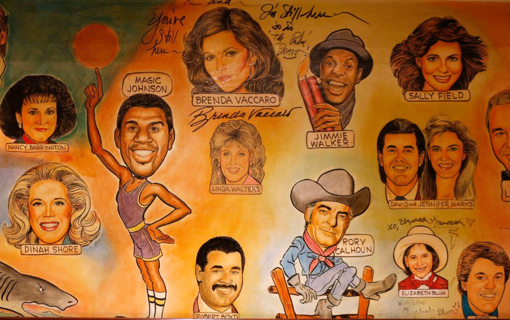 Artwork on display on the walls of the Palm Restaurant in Dallas on Friday, June 30, 2017. The Palm closed, after 33 years of business.